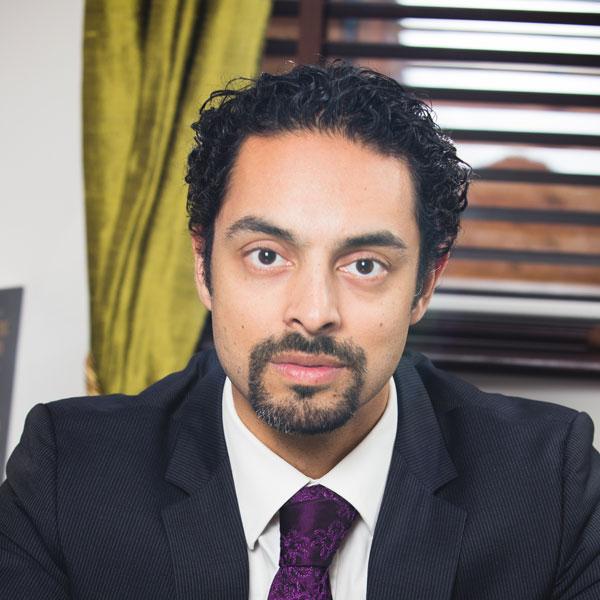 Dr. Julian De Silva
